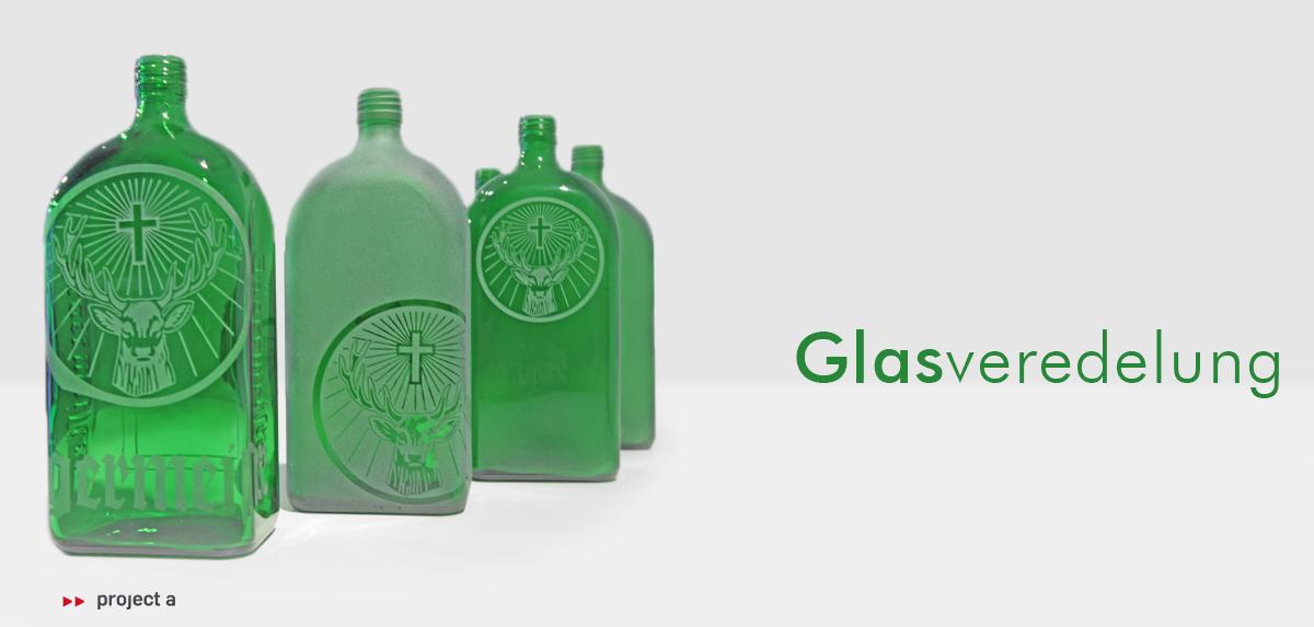 glasveredelung, jägermeister, sandstrahlen, project a, christopher baer, glasoberfläche, ätztechnik, glaskunst, pulverbeschichtung